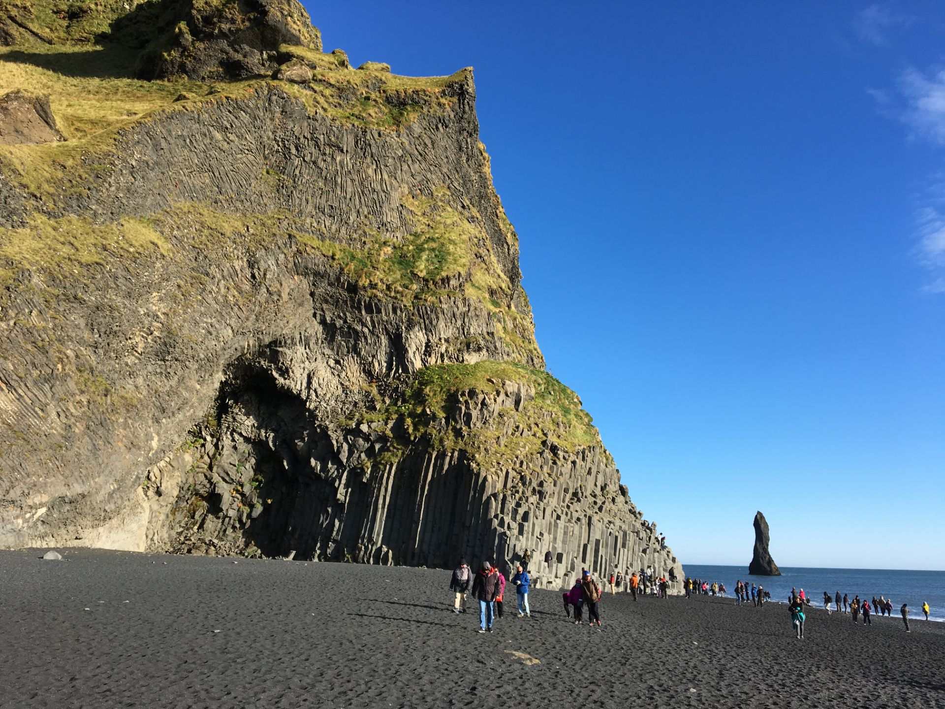 6703914e Images of the Black Beach showing the black sand/pebbles, the jagged cliff  face and the stacks/stumps on coast edge.
