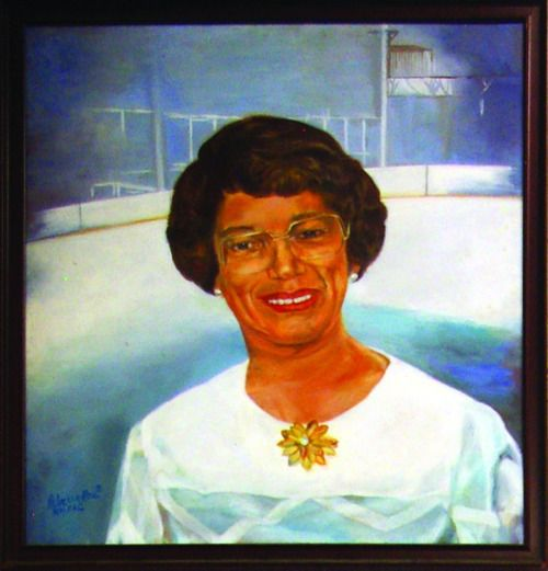 Portrait of Laura Sims displayed at the skate house named in her honor.